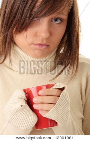 A beautiful girl (young woman) wearing polo neck sweater  holding a cup of hot drink