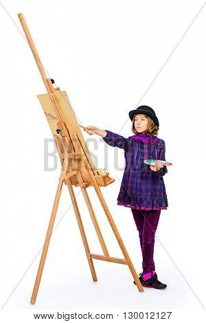 Young artist girl with her easel and palette of colors. Hobby, occupation. Isolated over white.