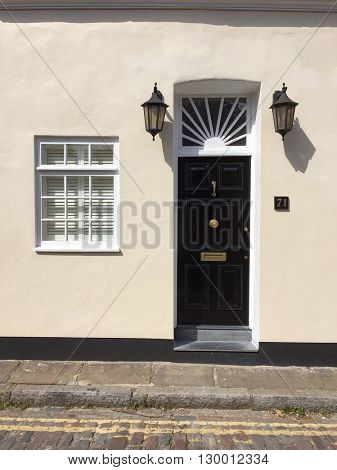 LONDON - MAY 16: Smart house entrance with black front door on May 16, 2016 in Hampstead, London, UK.