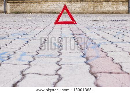 Red Warning Triangle Sign On Road