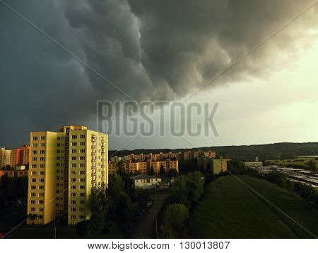 Storm over city in summer. Black clouds. Summer storm. Dark clouds.