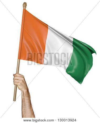 Hand proudly waving the national flag of Ivory Coast, 3D rendering