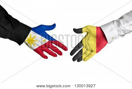 Philippines and Belgium leaders shaking hands on a deal agreement