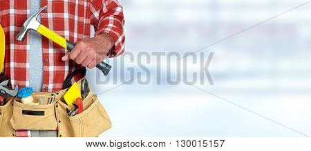 Hand of worker with a hammer.