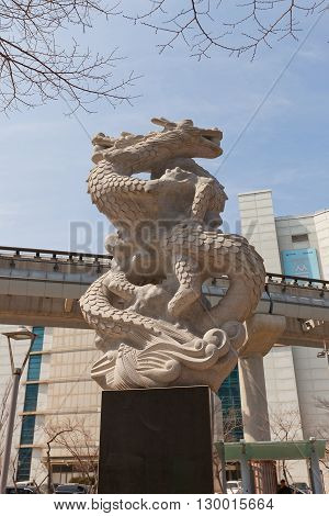 SEOUL SOUTH KOREA - MARCH 23 2016: Sculpture of a dragon (2002) the Biryong Cadastral Triangulation Station in Seoul Korea. The starting spot of construction of Incheon International Airport