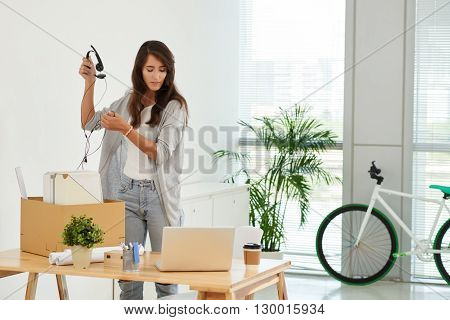 Business woman at new workplace unpacking her stuff
