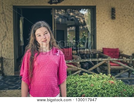 10-11 year old girl in the garden of hotel.