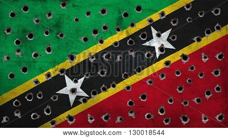 Flag of Saint Kitts and Nevis painted on wall with bullet holes