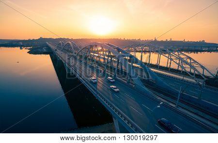 Darnitskiy bridge across Dnepr river against sunset sky. Kiev, Ukraine