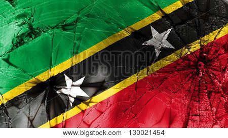 Flag of Saint Kitts and Nevis painted on broken glass