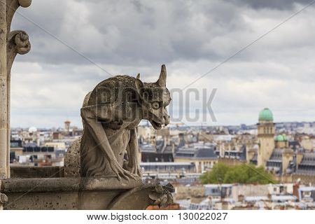 Paris, France - May 13: This is one of the statues of chimeras are installed on the top floor at the foot of the towers of Notre-Dame de Paris May 13, 2013 Paris, France.