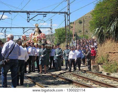Alora Spain 24 April 2016: Religious procession crossing railway line near Alora Andalucia. Alora Spain 24 April 2016
