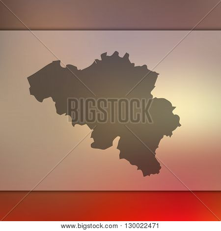 Blurred background with silhouette of Belgium.