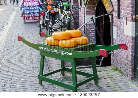Amsterdam, Netherlands - May 5: This is typical stretcher carrying cheeses at the entrance to the cheese shop in Amsterdam flower market May 5, 2013 in Amsterdam, Netherlands.