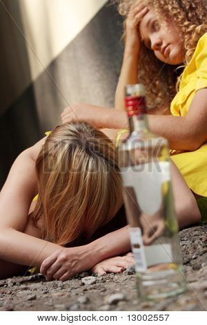Teen alcohol addiction (drunk teens with vodka bottle) | Stock photo