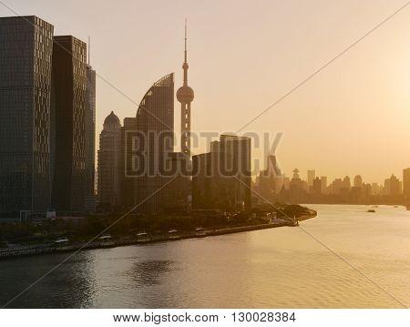 Shanghai skyline and Huangpu river in a beautiful dusk scene with sunset glow