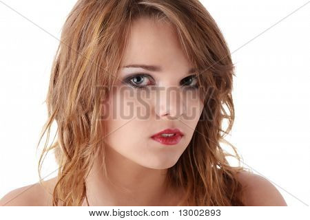 Sad teen girl with tears in her eyes isolated