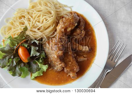 homemade slow cooked spared rib with spaghetti and salad