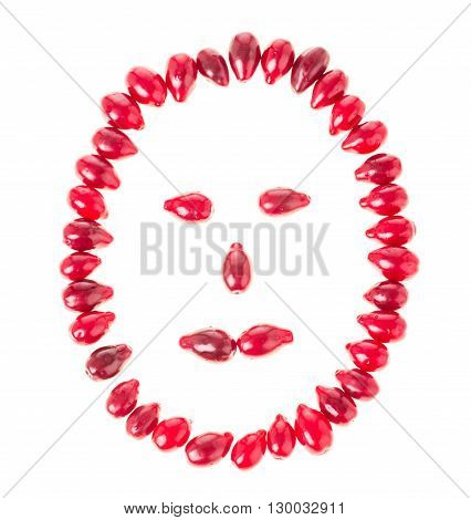 Ripe red dogwood berries in form of a human face. Isolated on a white background.