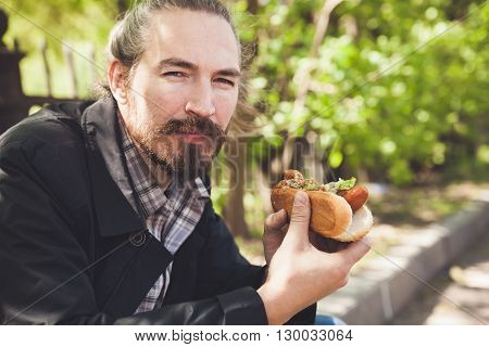 Bearded Asian Man With Hot Dog, Outdoor Lunch
