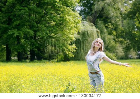 Women enjoying nature in meadow. Outstretched arms fresh morning air summer Field at sunrise.