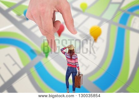 Rear view of a hipster woman holding suitcase against map app