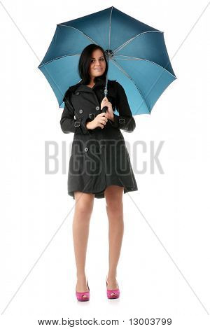 Beautiful young woman in black coat pink high heels with blue umbrella isolated on white background