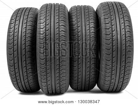 Complete set of new tyres for car on white background