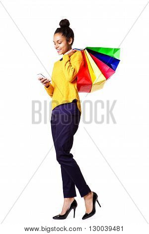 Female Shopper Using Mobile Phone