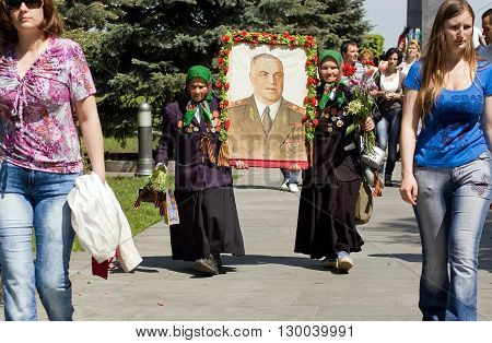 Kyiv, Ukraine - May 8, 2009: Senior female veterans carry a portrait of Georgy Zhukov during Victory Day celebration at the Museum of The History of Ukraine in World War II in Kyiv