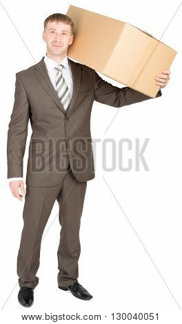 Young courier with carton box on shoulder. Looking at camera. Isolated on white background