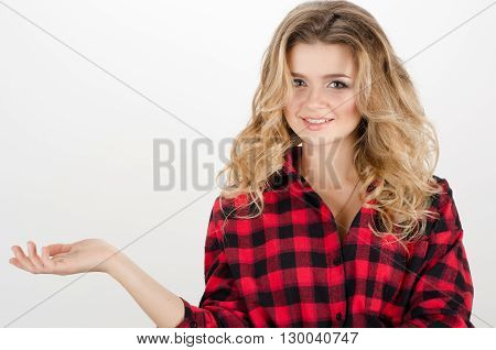 Smiling Woman Showing Open Hand Palm With Copy Space