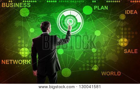Man working on futuristic touch panel. Technology concept
