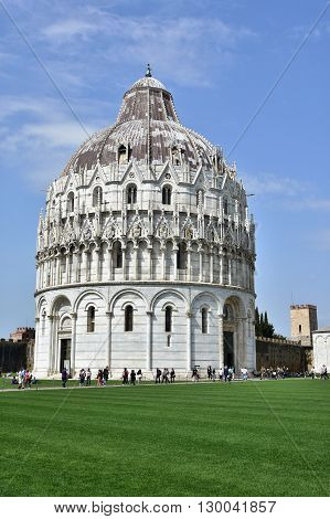 PISA, ITALY - APRIL 4: Piazza dei Miracoli square with Pisa Baptistery and ancient walls APRIL 4, 2016 in Pisa, Italy