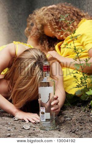 Teen alcohol addiction (drunk teens with vodka bottle)
