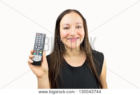 Closeup of a smiling woman holding a remote control with white background