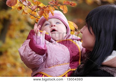 Mother and Child in yellow autumn forest