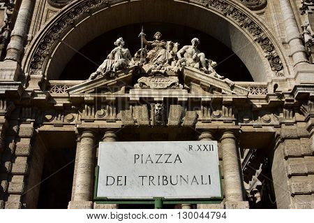 Old marble sign of Court of Justice Square right in front of the old Palace of Justice in Rome built in a neo-baroque style at the end of 19th century