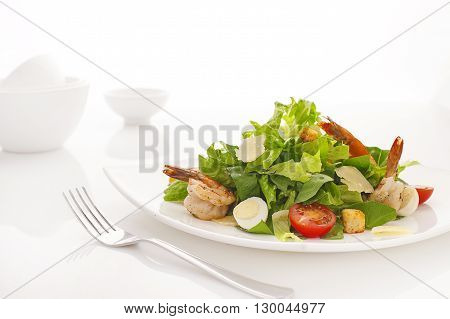 Caesar Salad with shrimps on white background