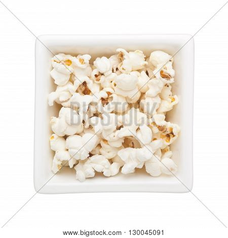Plain popcorn in a square bowl isolated on white background
