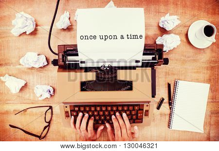 Once upon a time message on a white background against above view of old typewriter