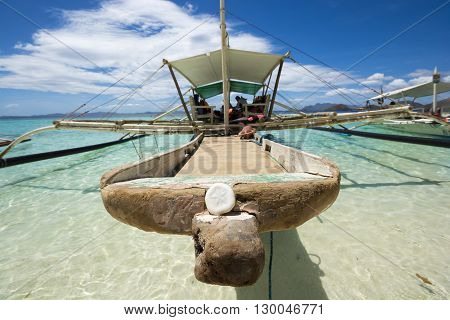 Mooring up on a filipino banka outrigger boat in Coron islands, Philippines