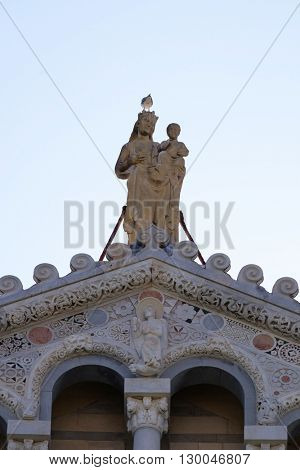 PISA, ITALY - JUNE 06, 2015: Virgin Mary with baby Jesus, Cathedral St. Mary of the Assumption in the Piazza dei Miracoli in Pisa, Italy. Unesco World Heritage Site, on June 06, 2015