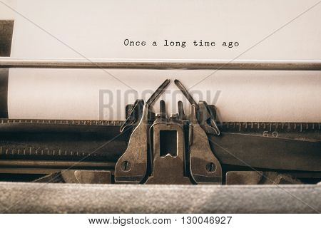 Once a long time ago message on a white background against close-up of typewriter