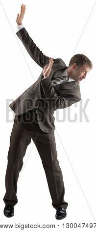 Isolated business man dodge something on white background