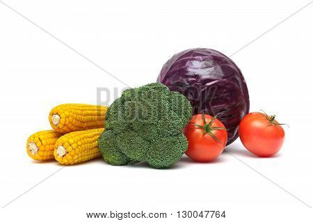 broccoli tomatoes corn and red cabbage on a white background close-up. horizontal photo.