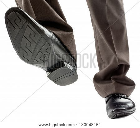 Feet of man in black shoes isolated on white background