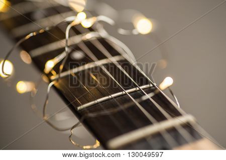 Electric guitar frets with strings and lights