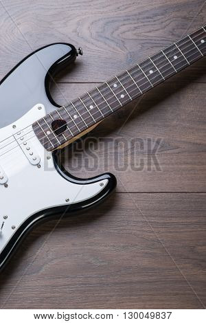 Electric Guitar With Mediator On A Brown Wooden Floor