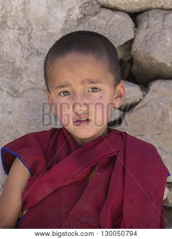 LAMAYURU INDIA - JUNE 20 2015: Unidentified buddhist young monk during Tibetan Festival at Ladakh North India